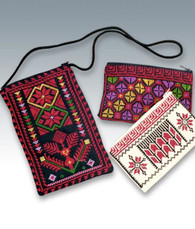 Eyeglass cases in black material with multicolor embroidery; evening purses and cosmetic purses are off-white with red and black embroidery, or black with multicolor embroidery.