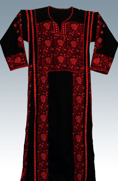 Lovely long black dresses with multicolored embroidery on the bodice and on the sides and back.