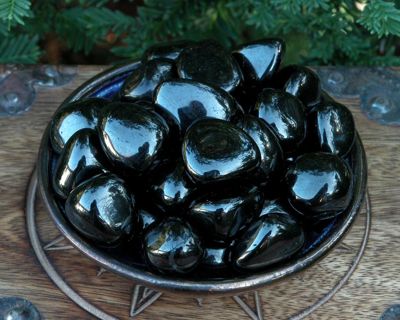 jet black tumbled fossilized gemstone