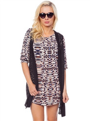 CREAM AND BLACK OPTICAL ILLUSION PRINTED DRESS WITH THREE-QUARTER SLEEVES!