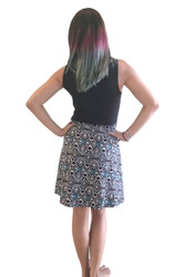 Black Skater Dress With Teal Peacock Tribal Pattern.