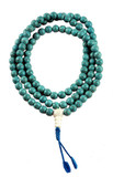 Turquoise Howlite Mala with a Shell Bead