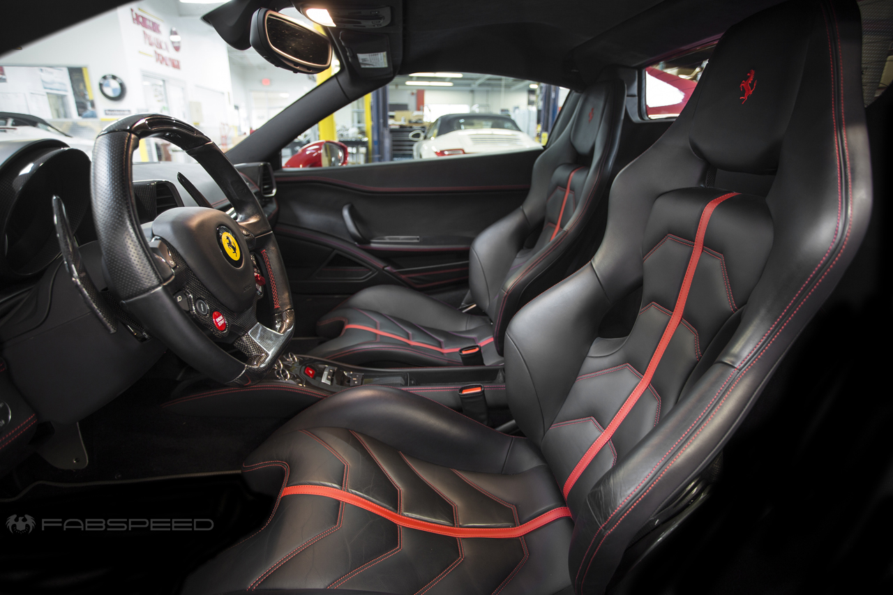 The perfectly spec'ed black and red interior looks downright perfect in the 458, but would also be right at home in Darth Vader's Tie-Fighter, ...