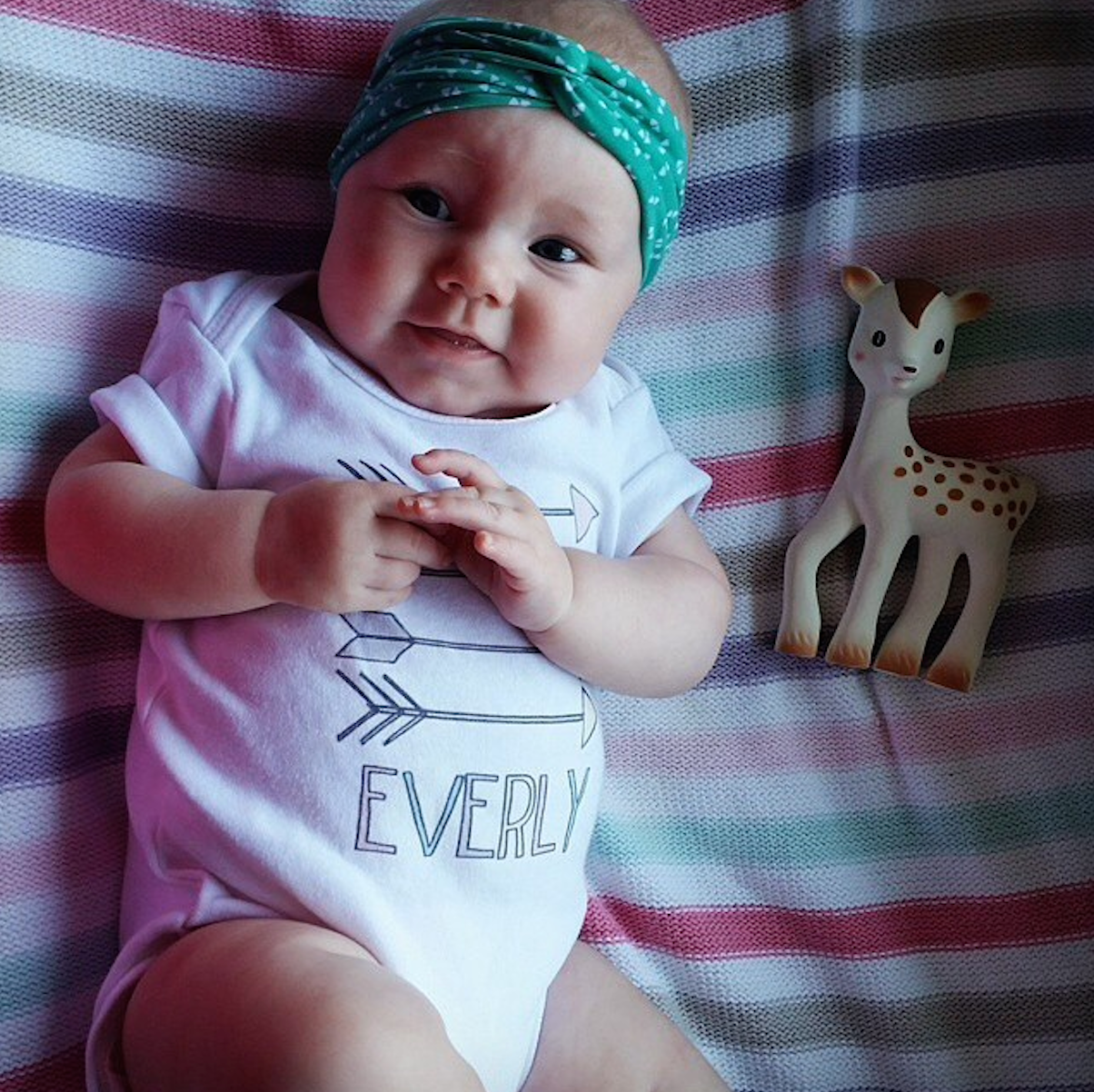 Everly in our Aztec Arrows Baby Name Onesie (customer photo via Instagram @shaarneeee)