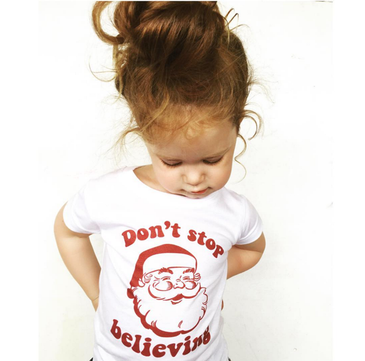 Don't stop believing retro Santa tee worn by Evie from @sheloveslaughslives