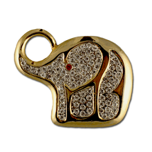 This beautiful elephant pin/brooch is complimented with white diamond like Swarovski crystals and one red crystal for the eye. Gold-plate only.