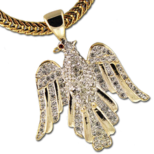 "This beautiful Eagle Neckslide is adorned with diamond like Swarovski crystals and makes a great statement!  (Size: Approx. 2.5""h x 1.75""w, goldplate). Chain not included."