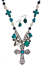 "A very pretty set is this necklace and earrings with variety of crosses in Turquoise/silverplate. Length approx 18"", Big cross 2.3"" x 3"", Lobster claw clasp with 3"" extender, Lead and nickel compliant."