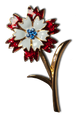 "Patriotic Carnation brooch/pin in red and white enamel with blue Swarovski crystals in center of the flower. Goldplate, 2""H x 1""W."