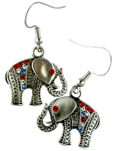 "These Elephant euro-wire earrings are pewter toned and the jeweled blanket is adorned with red, white and blue crystals.  The eye is a red crystal. Approx. 5/8""."