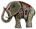 "This Elephant brooch/pin is pewter toned and the jeweled blanket is adorned with red, white and blue crystals.  The eye is a red crystal. Approx 1""."