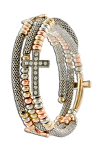 Predominantly silver coil bracelet with 3 side crosses encrusted with diamond-like crystals surrounded by bronze, gold and silver beads.