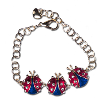 Red and Blue Enamel and Diamond-like Swarovski Crystals.