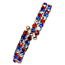 The coiled bracelet is flexible and can be fitted to all different sizes of wrist. Goldplate with red, white and blue crystals.