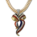 Gold-plate, enamel with Swarovski crystal ribbon pendant in the shape of a bow. (Chain sold separately).