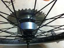 Photo showing an Installed Gas Powered Bicycle Motor Clamshell Sprocket Adapter Large.