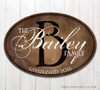 Oval wood family name sign