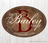 Oval wooden last name sign