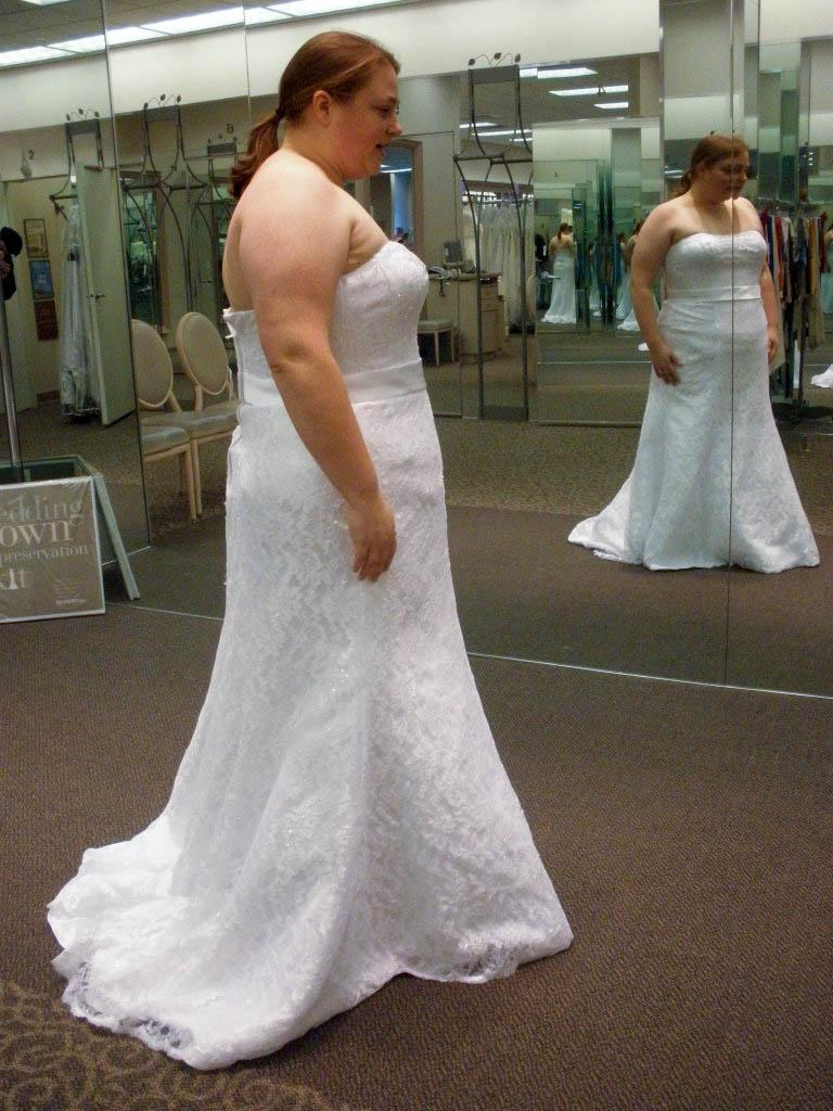 Pick a wedding dress that looks good on you not solange for Plus size wedding dresses near me