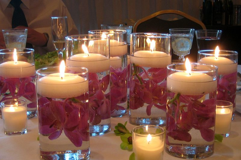 Liven your look and save money with do it yourself wedding try placing votive candles in hurricane jars lined with some simple lace or fill those jars with colored stones or sea shells solutioingenieria Images