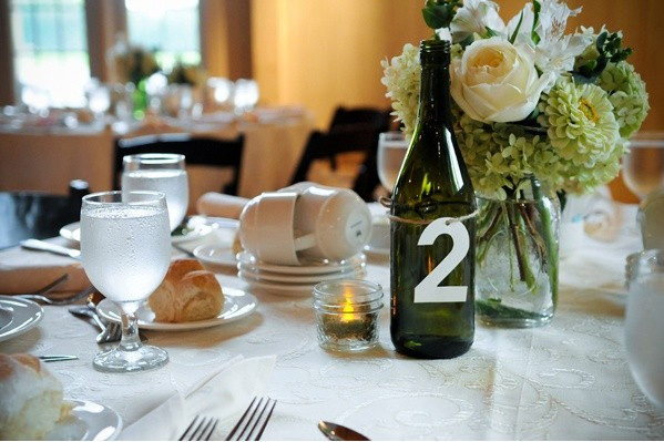 9 easy diy wine bottle centerpieces for Wedding table decorations with wine bottles