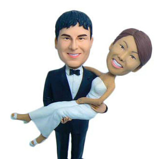Groom Holding Bride Cake Topper