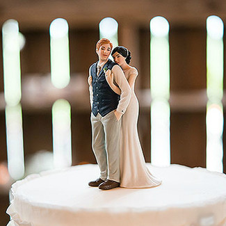 Bride Embracing Groom Wedding Cake Topper