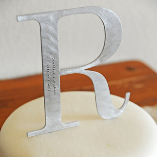 Silver monogram wedding cake topper