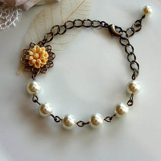 A Light Yellow Daisy and Swarovski Ivory Pearl Bracelet