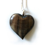 Dark horse hoof heart necklace.