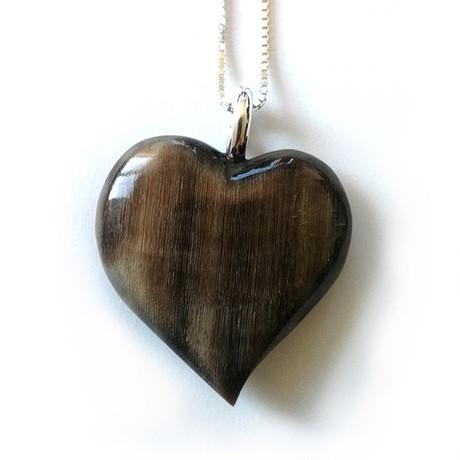 Dark horse hoof heart necklace.
