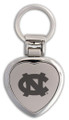 A silver heart shaped key ring with an interlocking NC engraved on the front.
