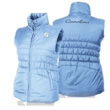 Carolina Blue ladies sized vest with an interlocking NC on the left chest and Carolina in a script across the back.