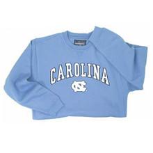 Carolina blue crewneck sweatshirt with Carolina in an arc over the interlocking NC.