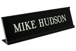 "Shown is 2"" x 8"" name plate in black desk frame (K32) from Cool School Studios."