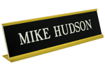 """Images displayed shows 2"""" x 10"""" name plate in gold desk frame (K35) from Cool School Studios."""