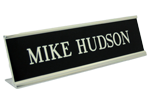 """Pictured is 2"""" x 10"""" name plate in silver desk frame (K36) from Cool School Studios."""