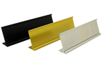 """Image shows three finishes on the 2"""" x 8"""" name plate holder (28DH) from Cool School Studios."""