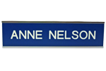 """Shown is 2"""" x 10"""" Silver Metal Wall Frame with Sign Plate (W36) for Cool School Studios."""