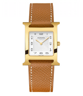 Hermes Heure H watch with yellow gold and brown leather band.