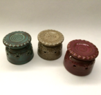 Biscuit cutters shown here with turquoise, oatmeal and plum glazes.