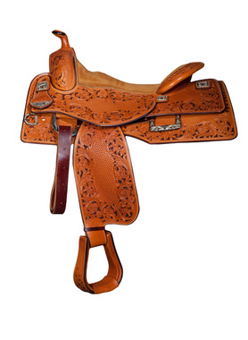 Bob Avila Reiner - B12-0009 This Bob Avila Reiner is for the person that wants to be noticed! It has a beautiful floral and basket tooling pattern with the background of the floral dyed a dark brown. The square iron and silver conchos and matching Square D Rings are an excellent compliment to the saddle.