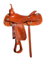 Bob Avila Cowhorse B11-0002 This Bob Avila Cowhorse features the popular slick seat with a medium oil finish. It is smooth leather with floral tooled accents on the corners and fenders. The Sliver conchos are surrounded with nail heads that really give this saddle a nice look.
