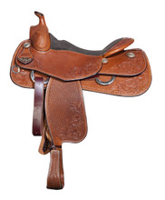Bob Avila Reiner B11-1109  This Bob Avila Reiner is a fantastic saddle for a great price it is a medium oil with a flor and basket tooling it also has conchos that are silver and iron combination.