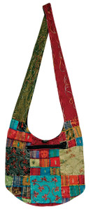 Hobo style bag with zipper close and great individual patches zipper on front