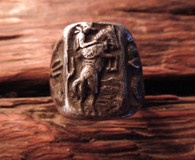 The top of the rings shows a cowboy on a bucking bronc or rather a raring bronc looks like the lone Ranger and Silver!