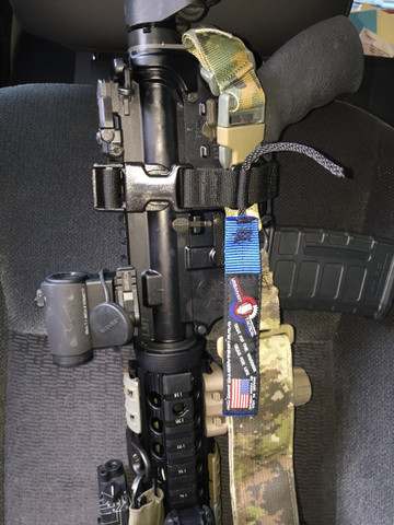 This shows the RIP Sling securing an M4 to the passenger seat muzzle down.