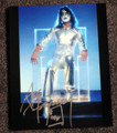Ace Frehley Signed KISS Sitting in Clear Chair Photo
