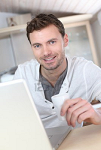 13806731-man-drinking-coffee-in-front-of-laptop-computer.png