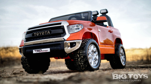 Orange Tundra front driver side view rubber tires